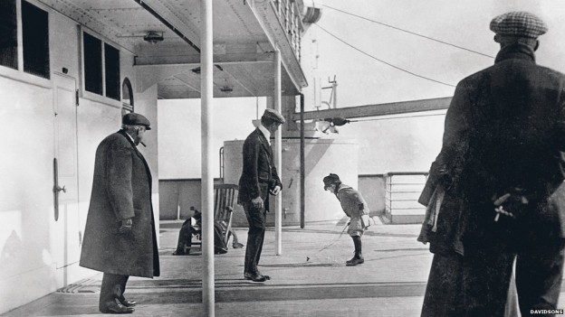 This father and son shown on the deck of the Titanic were preserved in this photo by Father Francis Browne who disembarked from the ship in Ireland, thus saving the only photos from the ship while it was at sea.