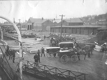 Coffins of dead from Titanic offloaded from Mackay-Bennett at naval dockyard at Halifax.
